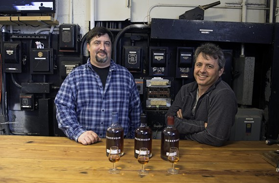 Reservoir Distillery owners Jay Carpenter and Dave Cuttino are childhood friends who decided during a Virginia Tech football game to go into the whiskey-making business. - SCOTT ELMQUIST