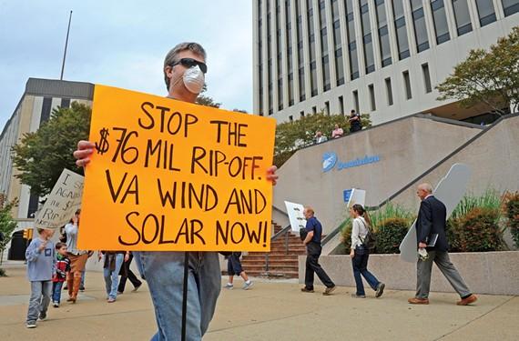 Richmond environmental activist Scott Burger joins a group of protestors Monday outside Dominion Resources' downtown offices. - SCOTT ELMQUIST