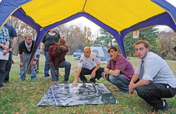 Richmond police Maj. Steve Drew speaks with Occupy Richmond protesters in Ray Boone's yard. - SCOTT ELMQUIST
