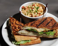 Roasted corn salad and the Peruvian chicken sandwich with caramelized onions, avocado and provolone are top sellers at the Cellar Door, best finished with the Mexican chocolate torte.
