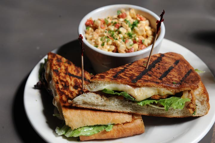 Roasted corn salad and the Peruvian chicken sandwich with caramelized onions, avocado and provolone are top sellers at the Cellar Door, best finished with the Mexican chocolate torte. - SCOTT ELMQUIST/FILE