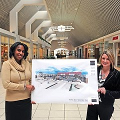 Robin McBride and Sharon North show off Federal Realty's redevelopment plans for the Shops at Willow Lawn, which includes demolishing the indoor portion.  Photo by Scott Elmquist