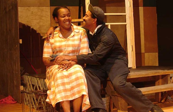 """Rochelle Turnage as Rose and J. Ron Fleming as Troy in August Wilson's """"Fences,"""" running through November 20 at Pine Camp Cultural Arts Center."""