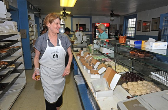Sally Bell's Kitchen co-owner Martha C. Jones readies the line for boxed lunch sales at the local landmark. - SCOTT ELMQUIST