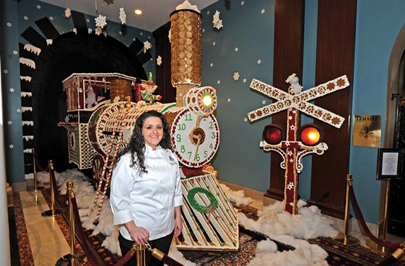 Sara Ayyash says it wasn't easy decorating Santa's steam engine at the Jefferson Hotel, but the results are a hit with visitors. Master carpenter Steve Corwin built the framework. - SCOTT ELMQUIST