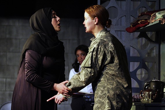 """Sara Heifetz as Adiliah (left), McLean Jesse as Mabry Hoffman (right) and Katrinah Carol Lewis as Kate Moore (background center) do excellent work in the powerful new drama """"The Human Terrain"""" about the Iraq War. - JENNIFER BLACKMER"""