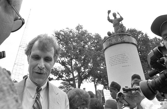 Sculptor Paul DiPasquale at the dedication of the Arthur Ashe momument in 1996.