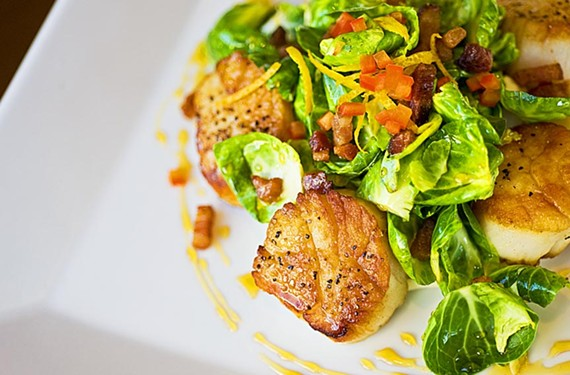 Seared scallops are among the seafood highlights on a healthy-food menu at the busy new Carytown café the Daily Kitchen & Bar. - ASH DANIEL
