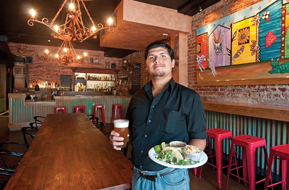 Server Kevin Arroyo suggests an Agave wheat beer to go with the carnitas and carne asada plate with frijoles charros and rice at Tio Pablo in Shockoe Bottom. - SCOTT ELMQUIST