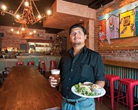 Server Kevin Arroyo suggests an Agave wheat beer to go with the carnitas and carne asada plate with frijoles charros and rice at Tio Pablo in Shockoe Bottom.