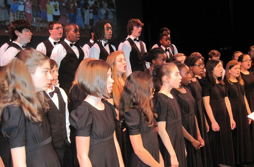 Sharing the happiness: The young singers who make up the Greater Richmond Children's Choir will soon be showcasing their talents for audiences in England and Ghana. - ANNE WILLIFORD