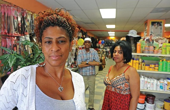 Sharon Scales and Janet Johnson, with their father, Edward Johnson, decided to continue operating Kate's Beauty Express in the city's North Side after the shop's namesake — their sibling — was shot to death. - SCOTT ELMQUIST