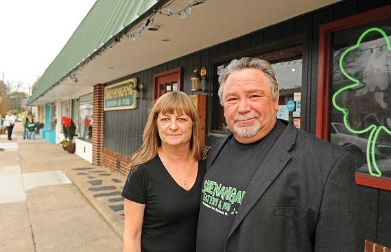 Shenanigans owner Allen Davis, with longtime general manager Kathy O'Bryant, likens the loss of his lease to getting hit by a tornado. - SCOTT ELMQUIST