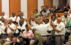 Sheriff C.T. Woody and dozens of his deputies fill council chambers Thursday night. The conditions at the overcrowded jail, which can get hotter than 100 degrees in the summer, becomes the most powerful argument in favor of approving the contract during Thursday's meeting. - SCOTT ELMQUIST