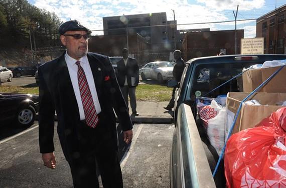Sheriff C.T. Woody inspects a truckload of socks outside the city jail. - SCOTT ELMQUIST