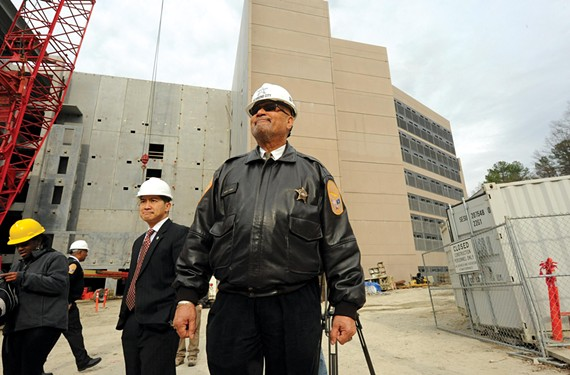Sheriff C.T. Woody inspects progress on a new city jail, which will hold about 350 fewer prisoners than the current one. - SCOTT ELMQUIST