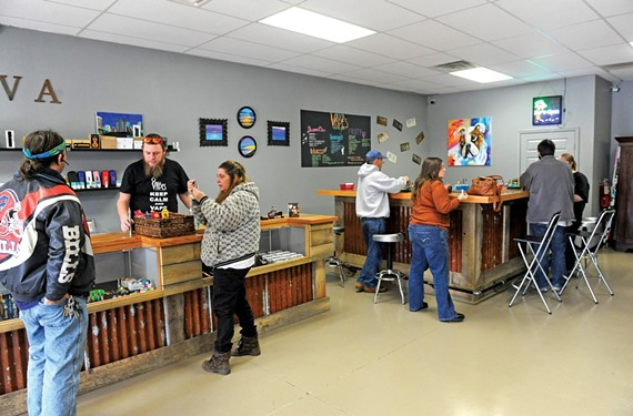 Shoppers attend the RVA Vapes grand opening Feb. 1 on West Broad Street. - SCOTT ELMQUIST