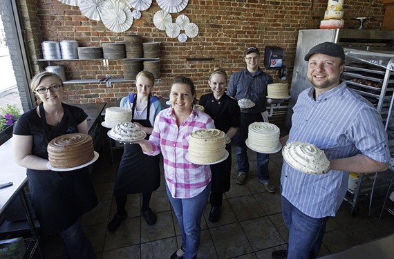 Shyndigz shows off cake-icing skills in a streetside window at its new location in the Fan. Owners Nicole and Bryon Jessee are in the foreground center; their baking and decorating staff includes Lindsay Fletcher, Chelsea Peterson, Alexa Pinzón and Chris Norris.