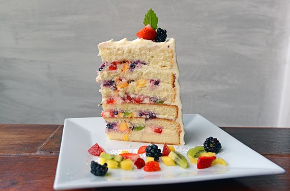 Shyndigz's fresh fruit cake features chunks of blackberry, kiwi, strawberry and pineapple adrift in cream cheese icing over vanilla cake.