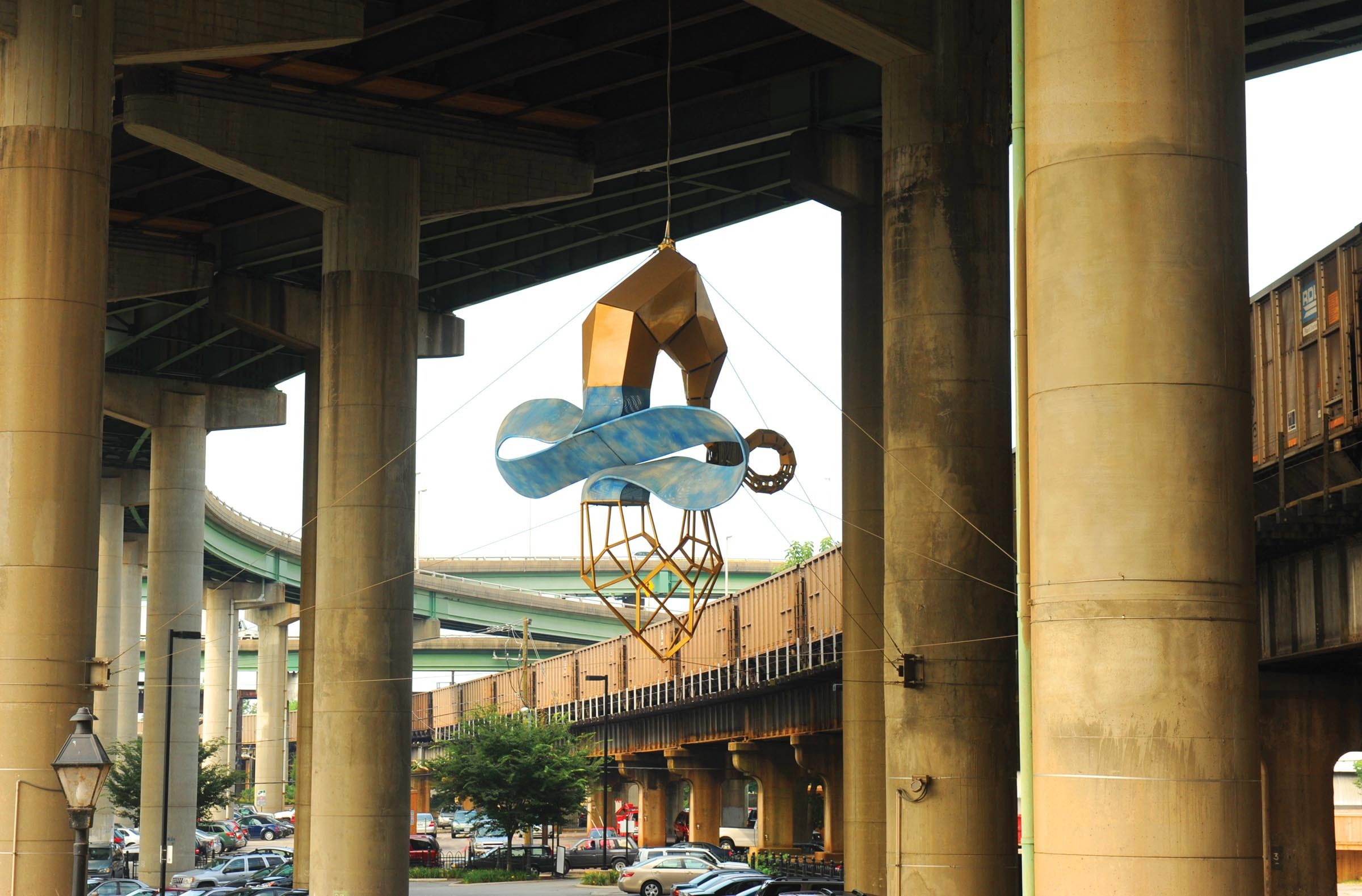 """""""Skyrider,"""" a 2003 sculpture by John Newman, hanging from Interstate 95 near the Main Street Station, is a Public Art Commission project. - SCOTT ELMQUIST"""