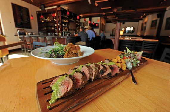Sliced filet of Angus shoulder chimichurri and fried pork cheeks are among the dishes at Viceroy in the Museum District, in the former Café Diem. - SCOTT ELMQUIST