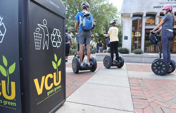 Some experts say Virginia Commonwealth University's environmental efforts could set a good example for the region. Here, students try out Segways on the university's annual Sustainability Day.