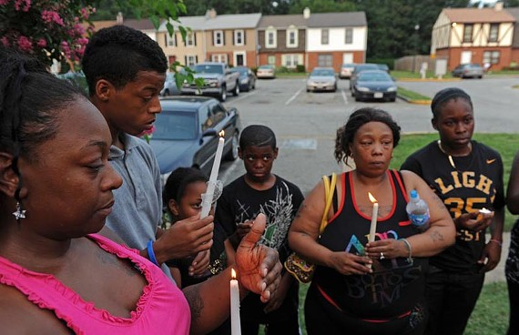"Spencer ""Jovon"" Ross is memorialized by aunt Sheri Ross, brother Markk Ross and extended family who gathered at a prayer vigil in his honor last week. - SCOTT ELMQUIST"