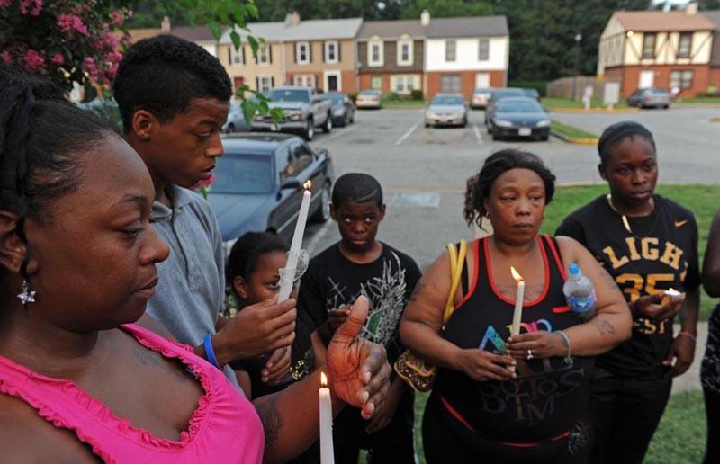 """Spencer """"Jovon"""" Ross is memorialized by aunt Sheri Ross, brother Markk Ross and extended family who gathered at a prayer vigil in his honor last week. - SCOTT ELMQUIST"""