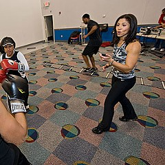 """Stacy Young's Fit Camp fitness classes are a sweaty synthesis of workout and dance-a-thon. """"It's a fun way to exercise,"""" says Fit Camp's DJ, Steve Anderson."""