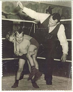 Steinborn, 6, and his brother, Henry, 8, grew up surrounded by wrestling. Here they are in 1939 with their father, Milo, in Paris.