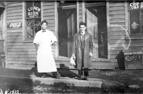 "Stilson captured these restaurateurs, whom he identified as Japanese, in Shockoe outside their establishment with clearly marked entrances and dining rooms for ""whites"" and ""colored."" - COPYRIGHT RICHMOND IN SIGHT"