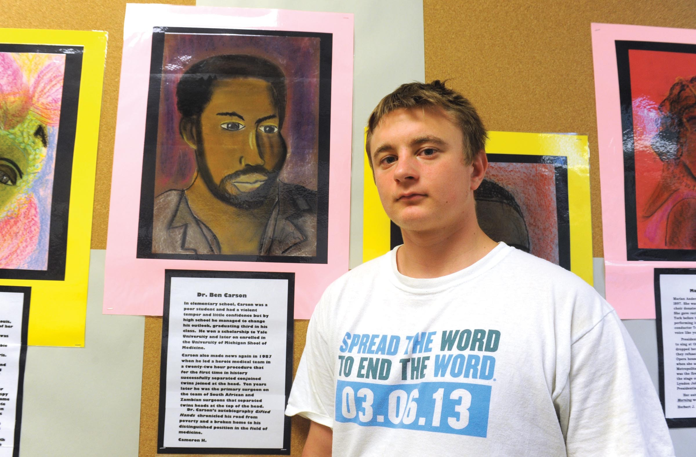 Student Cameron Hensley stands in front of a portrait he drew of Dr. Ben Carson, the controversial director of pediatric neurosurgery at Johns Hopkins University Hospital. (Below) An abridged poem by senior, Michael Rhoades. - SCOTT ELMQUIST
