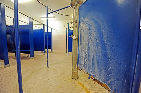 Student enthusiasm for P.E. is low throughout Richmond's public middle and high schools, in part because facilities, such as this girls' locker room at Armstrong High, are in poor shape. - SCOTT ELMQUIST