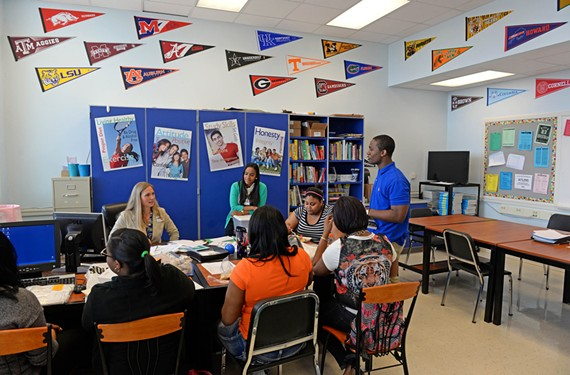 Students in their senior year at Lynchburg's E.C. Glass High School talk graduation and college in the school's Future Center with center director Heidi Vande Hoef, left, and to her right, Leidra Hickson, director of Heritage High Future Center. - SCOTT ELMQUIST