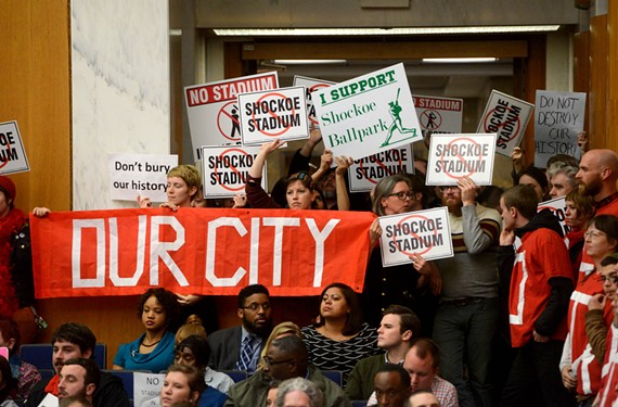 Supporters and opponents of the mayor's plan pack into City Hall on Feb. 24, before City Council votes 6-3 to move ahead with the stadium proposal. - SCOTT ELMQUIST