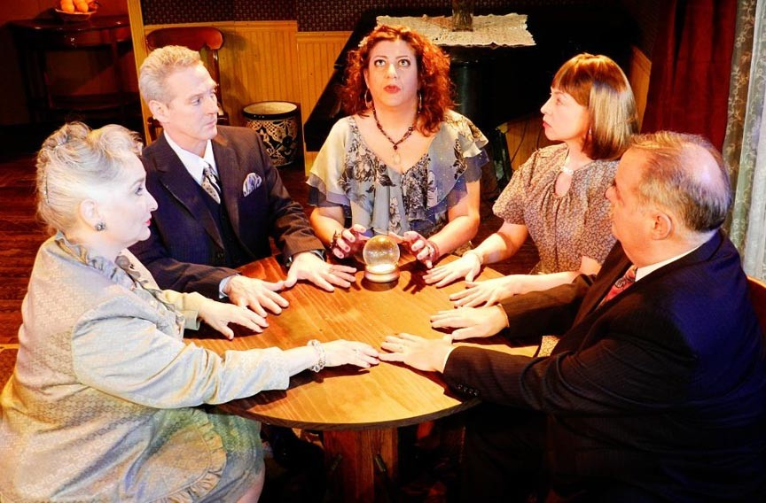 """Swift Creek's production of """"Blithe Spirit"""" perfectly captures Noël Coward's dry, sophisticated tone. From left, Jacqueline Jones, Richard Koch, Amy Berlin, Vivki McLeod and John Stork Maddox. - ROBYN O'NEILL"""
