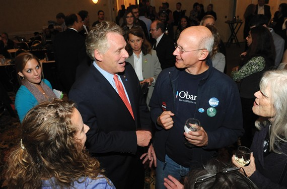 Terry McAuliffe and Glen Besa, director of the Virginia chapter of the Sierra Club, celebrate at Democratic headquarters at the Richmond Marriott on election night. - SCOTT ELMQUIST