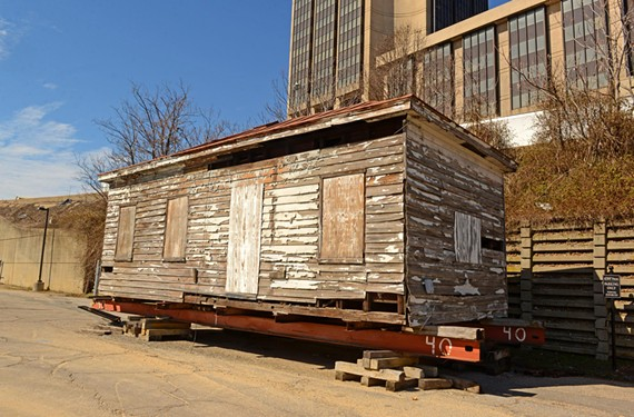 The 19th century home of Emily Winfree, a former slave, sits in a Shockoe Bottom parking lot near Interstate 95 awaiting a new permanent location and restoration. - SCOTT ELMQUIST