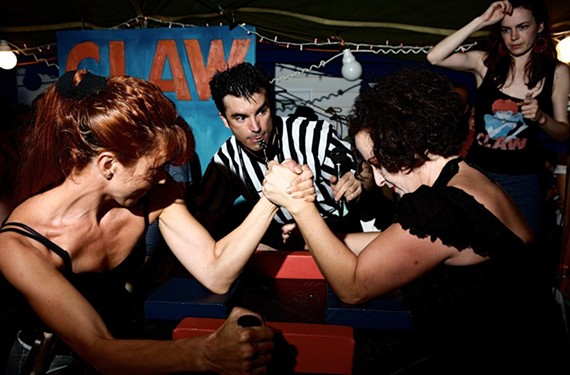The arm wrestling femmes fatale affiliated with CLAW (the Collective of Lady Arm Wrestlers) are bringing down barriers, one bicep at a time. - BILLY HUNT