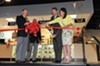 The attorney general helps cut the ribbon at the grand opening of Colonial Shooting Academy in the West End in April.