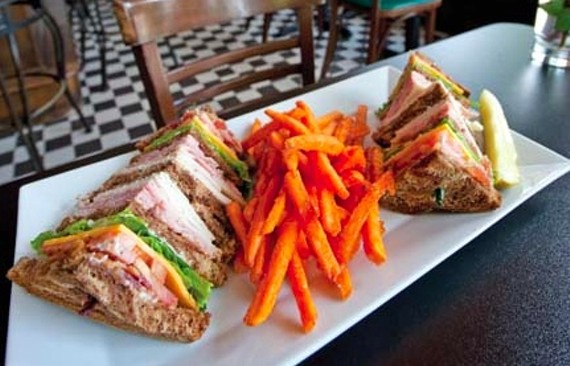 The Devil's Triangle club sandwich is served with sweet potato fries at the neighborhood's revamped hangout, the Franklin Inn. - SCOTT ELMQUIST