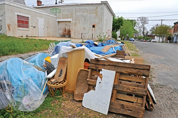 The ever-moving, jealously guarded pile has become a point of contention for Oregon Hill. - SCOTT ELMQUIST