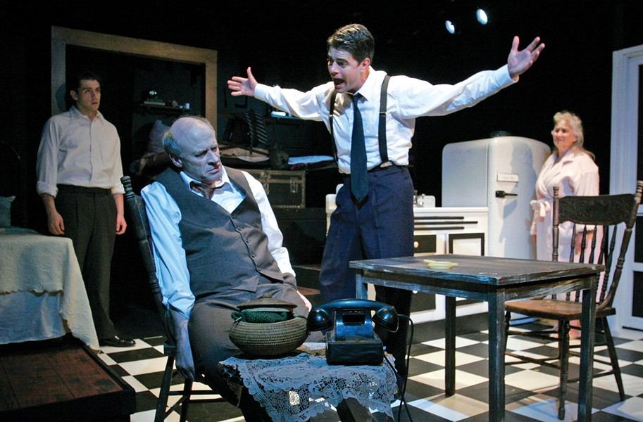 "The Firehouse Theatre Project's most recent production, ""Death of a Salesman,"" featured Joe Inscoe as Willy Loman, seated, and Adrian Rieder as Biff, standing — both of whom are protesting the theater's decision to dismiss Carol Piersol. - FIREHOUSE THEATRE"