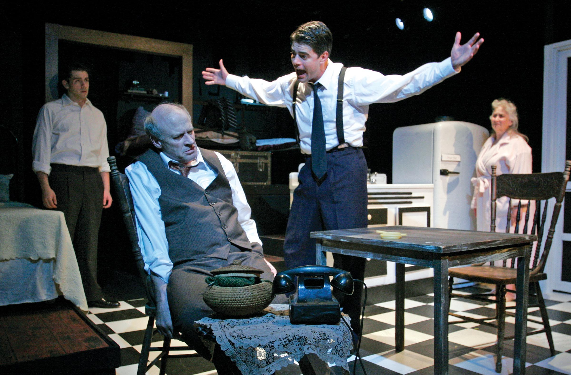 """The Firehouse Theatre Project's most recent production, """"Death of a Salesman,"""" featured Joe Inscoe as Willy Loman, seated, and Adrian Rieder as Biff, standing — both of whom are protesting the theater's decision to dismiss Carol Piersol. - FIREHOUSE THEATRE"""