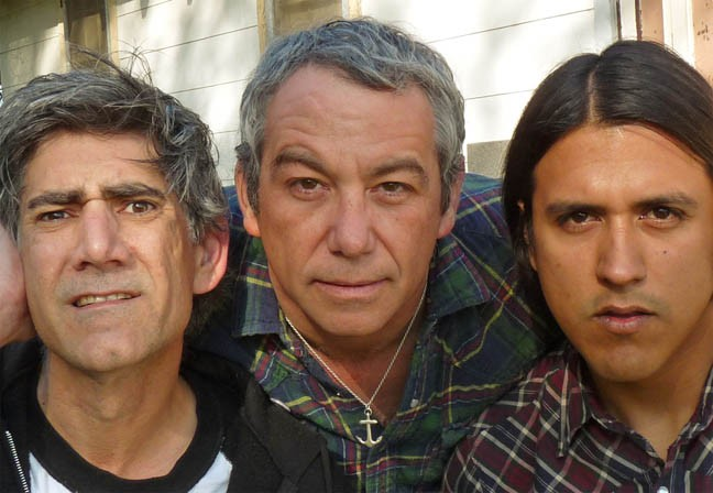 The first time our writer saw Mike Watt, center, perform in California, the bassist walked offstage during a song straight into the men's room and kept playing as he relieved himself. Here he's flanked by Tom Watson, left, and Raul Morales.