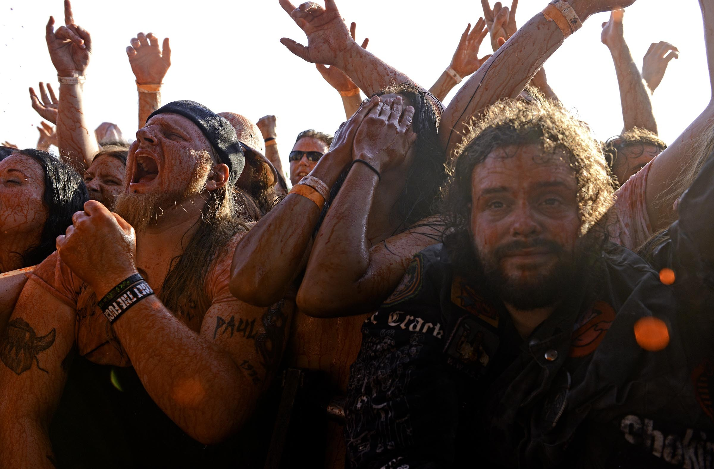 The front row is showered in fake blood at the 2014 Gwar B-Q. - SCOTT ELMQUIST