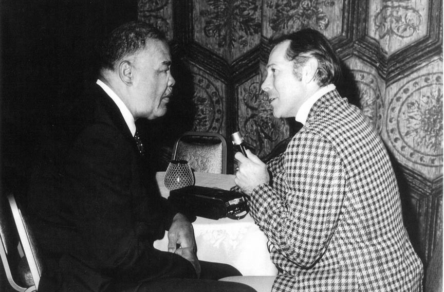 """""""The great Joe Louis, Joe DiMaggio, Ted Williams, you name 'em. If I see them, I wanted them,"""" Newbery says. Here, he interviews the former heavyweight champ in 1975."""