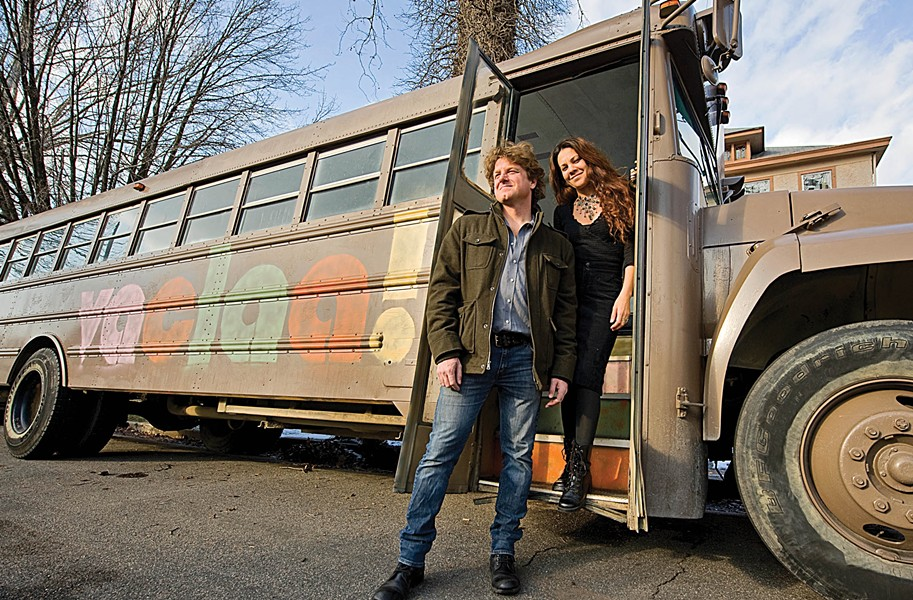 The husband-and-wife team of Eva Rocha and Spencer Turner stand in front of Galeria Movimiento, the mobile art gallery that seeks to help showcase local Hispanic and Latin American art. - ASH DANIEL