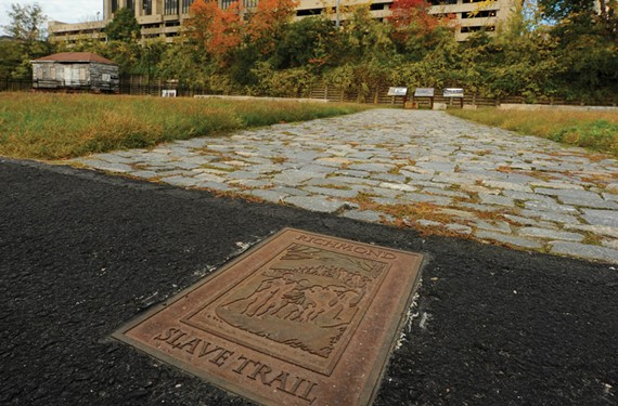 The Lumpkin's Slave Jail site, where slaves were kept before auction, was discovered in 2006 and excavated in 2008. Researchers recovered thousands of artifacts and found the building's foundations intact, as well as a cobblestone-paved central courtyard. - SCOTT ELMQUIST