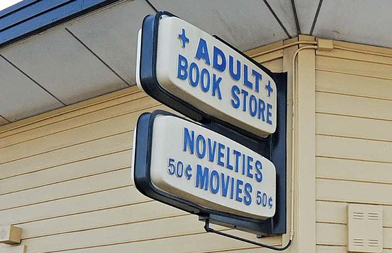 The plastic signs on the old Tri-Angle adult bookstore may be adopted by the Valentine Richmond History Center. - SCOTT ELMQUIST
